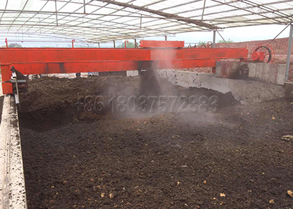 Large Scale Wheel Type Compost Turner Working in the Organic Fertilizer Production Plant